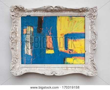 abstract art expressionism canvas in vintage antique white frame on the white wall. See more in my portfolio