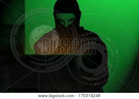 Hacker man in hoodie shirt typing hacking global netwok security on computer laptop over dark background with green light