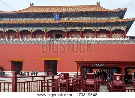 Beijing, China - Oct 30, 2016: Meridian Gate (Wumen) and security checkpoint; the main gateway into the Forbidden City (Gu Gong, Palace Museum). A hazy day.
