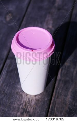 pink. paper coffee cup with a pink plastic lid. breast cancer awareness. coffee