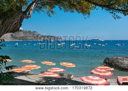 Giardini Naxos, ITALY - July 2016: View of the sea and coast of Giardini Naxos, near city Taormina, Sicily, Italy in August, 2015, Italy