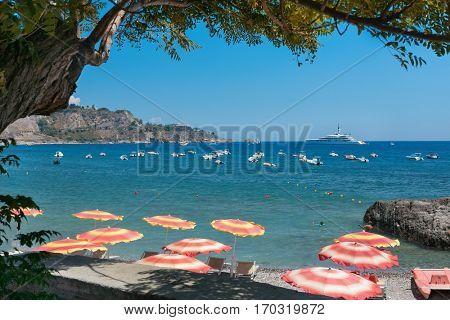 Giardini Naxos, ITALY - July 2016: View of the sea and coast of Giardini Naxos, near city Taormina, Sicily, Italy in August, 2015, Italy
