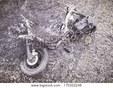Closeup of a burnt vintage motorbike outdoor