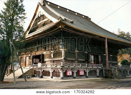 A wooden building at the Three-Storied Pagoda at the Narita-san Shinshō-ji Shingon Buddhist temple in Narita, Japan.