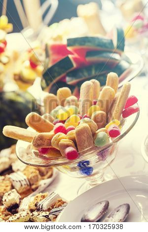 Candy buffet on a wedding  with a wide variety of candies and sweets