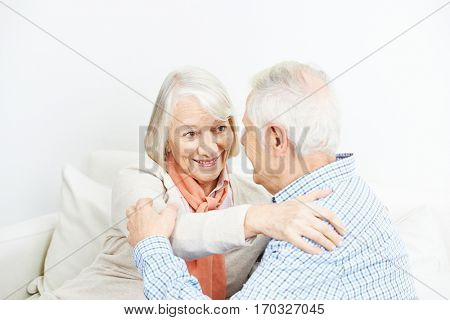 Happy senior couple in love embracing at home