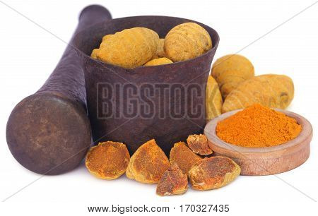 Whole and ground turmeric with mortar and pestle