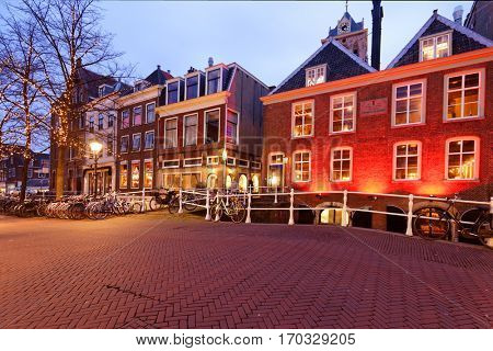 DELFT, NETHERLANDS - JANUARY 3, 2017: Bridge across a canal at Wijnhaven street. Delft is known for its historic town center with canals, and Delft Blue pottery