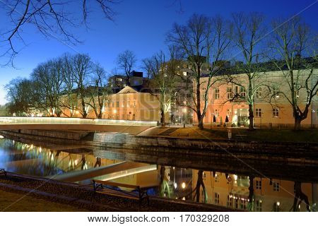 TURKU, FINLAND - DECEMBER 25, 2016: Embankment of river Aura in winter evening. Founded most likely at the end of the 13th century, Turku is the oldest city in Finland