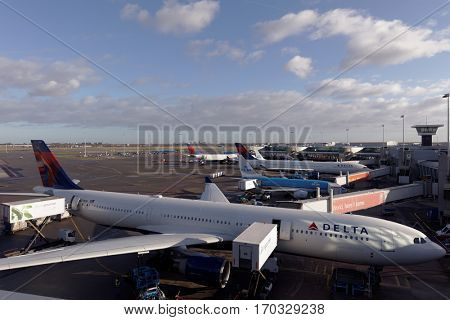 AMSTERDAM, NETHERLANDS - JANUARY 5, 2017: Uploading foods into the passenger aircraft of Delta Air Lines in the airport Schiphol. Delta is the sixth-oldest operating airline by foundation date