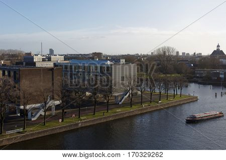 AMSTERDAM, NETHERLANDS - JANUARY 2, 2017: View to island Kattenburg. Historically this island was occupied by shipbuilders, and now it houses the Maritim History Museum