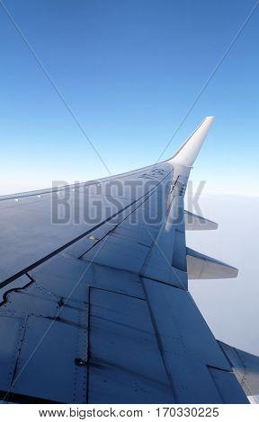 DELHI - KOLKATA, INDIA - FEBRUARY 07: Wing of Boeing 737 airplane from window