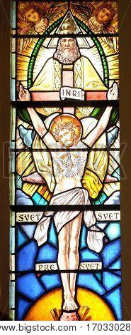 KRASIC, CROATIA - JUNE 11: Holy Trinity, stained glass window in the parish church of the Holy Trinity in Krasic, Croatia on June 11, 2016