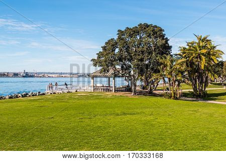 SAN DIEGO, CALIFORNIA - JANUARY 8, 2017:  Tourists enjoy the view from an overlook of the bay at Embarcadero Marina Park North.