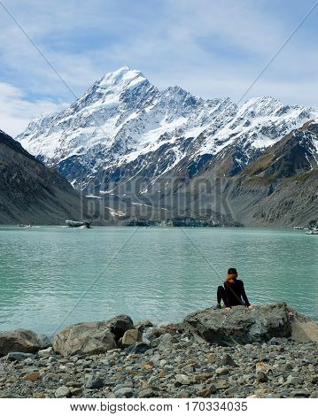 A Woman Enjoys Views of Hooker Lake and Mt Cook.  Mt Cook National Park, Southern Alps New Zealand