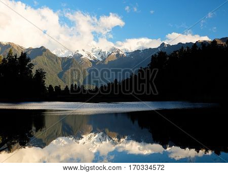 Lake Matheson Reflecting The Southern Alps.  Fox Glacier, Westland National Park, New Zealand.