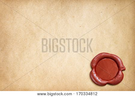 Old parchment paper letter with red wax seal