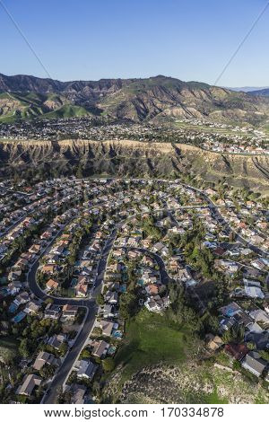 Aerial view of streets and homes in the suburban Porter Ranch neighborhood of Los Angeles California.