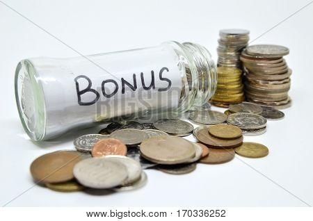 Bonus Lable In A Glass Jar With Coins Spilling Out