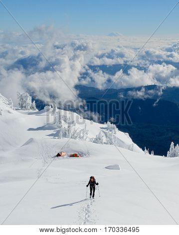A Woman Hiker Leaving High Camp on Mt Ellinor.  Olympic National Park, Washington.