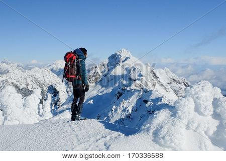 A Woman Hiker on the Summit of Mt Ellinor in Winter.  Olympic National Park, Washington.