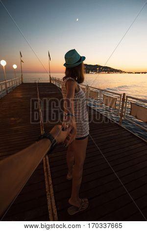 Girl holding a hand man on the beach in Alanya, Turkey