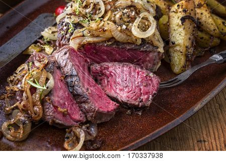 Wagyu Rib-Eye Steak Bleu with Fried Onion and Potatoes
