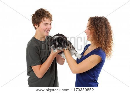 Happy woman and boy hold funny black rabbit isolated on white