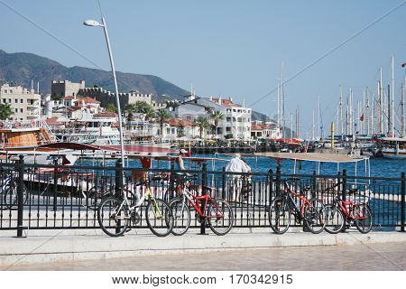 MARMARIS TURKEY - SEPTEMBER 11 View of Marmaris in 2012 with bicycles on front plan and ships buildins castle and mountains on background