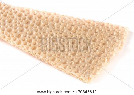 two grain crispbreads isolated on a white background.