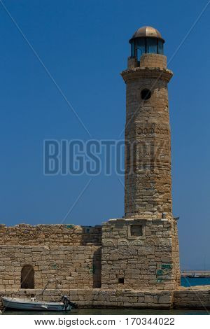 Rethymno Greece - July 30 2016: The old lighthouse. This lighthouse was built by the Egyptians during the decade of 1830 when the Turks handed Crete to the Egyptians. Possibly there was an older Venetian lighthouse at the site just like Chania harbor.