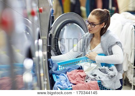 Girl by washing-machine