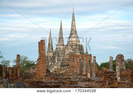 Сoudy morning on the ruins of the Buddhist temple of Wat Phra Si Sanphet. Ayuthaya, Thailand