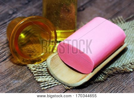 Cup massage tool correction bottles on woden background