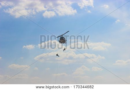 Fast-lope  leave helicopter show by airman.