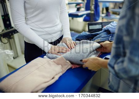 Taking pullover from dry-cleaning