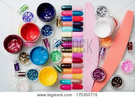 bright nail varnishes on the white table