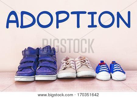 Adoption concept. Children shoes on white background