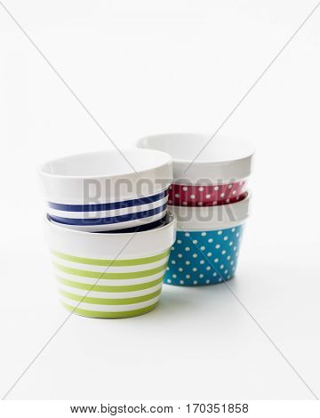 Colorful bowls on a white background.