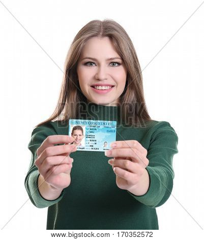 Woman with driving license on white background