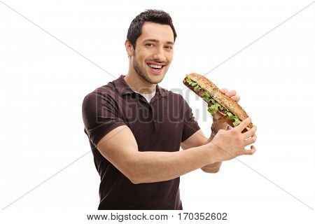 Young man having a sandwich and looking at the camera isolated on white background