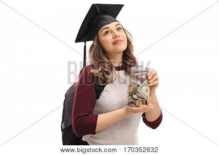 Female graduate student holding a jar filled with money and looking up isolated on white background