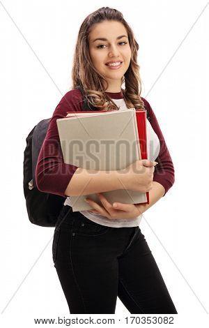Joyful female student with books isolated on white background
