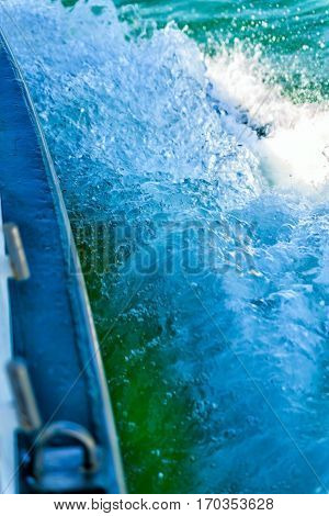 Water spray from boat racing in Italy