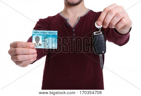 Man with driving license and car key on white background