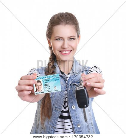 Woman with driving license and car key on white background