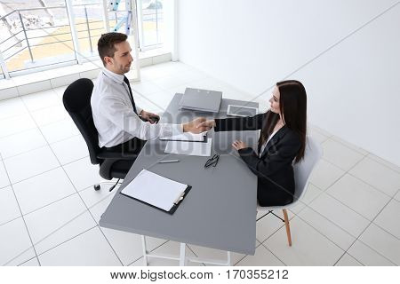 Job interview concept. Human resources manager shaking woman's hand