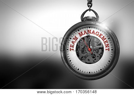 Business Concept: Vintage Watch with Team Management - Red Text on it Face. Business Concept: Team Management on Watch Face with Close View of Watch Mechanism. Vintage Effect. 3D Rendering.
