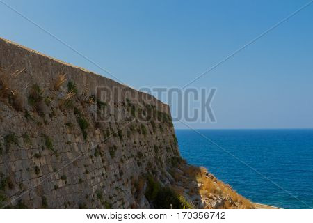Rethymno, Greece - July  30, 2016:  The Wall Of Fortezza Castle And Mediterranean Sea.