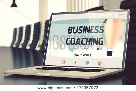 Business Coaching on Landing Page of Laptop Display in Modern Conference Hall Closeup View. Blurred. Toned Image. 3D Rendering.